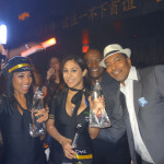 TAO Girls with AnestasiA Vodka Bottle and AnestasiA Team. Bruce Caughman, Brand Manager, & Holding Bottle, Tilford Brockett, Executive VP of Domestic Operations. TAO Nightclub, Las Vegas.