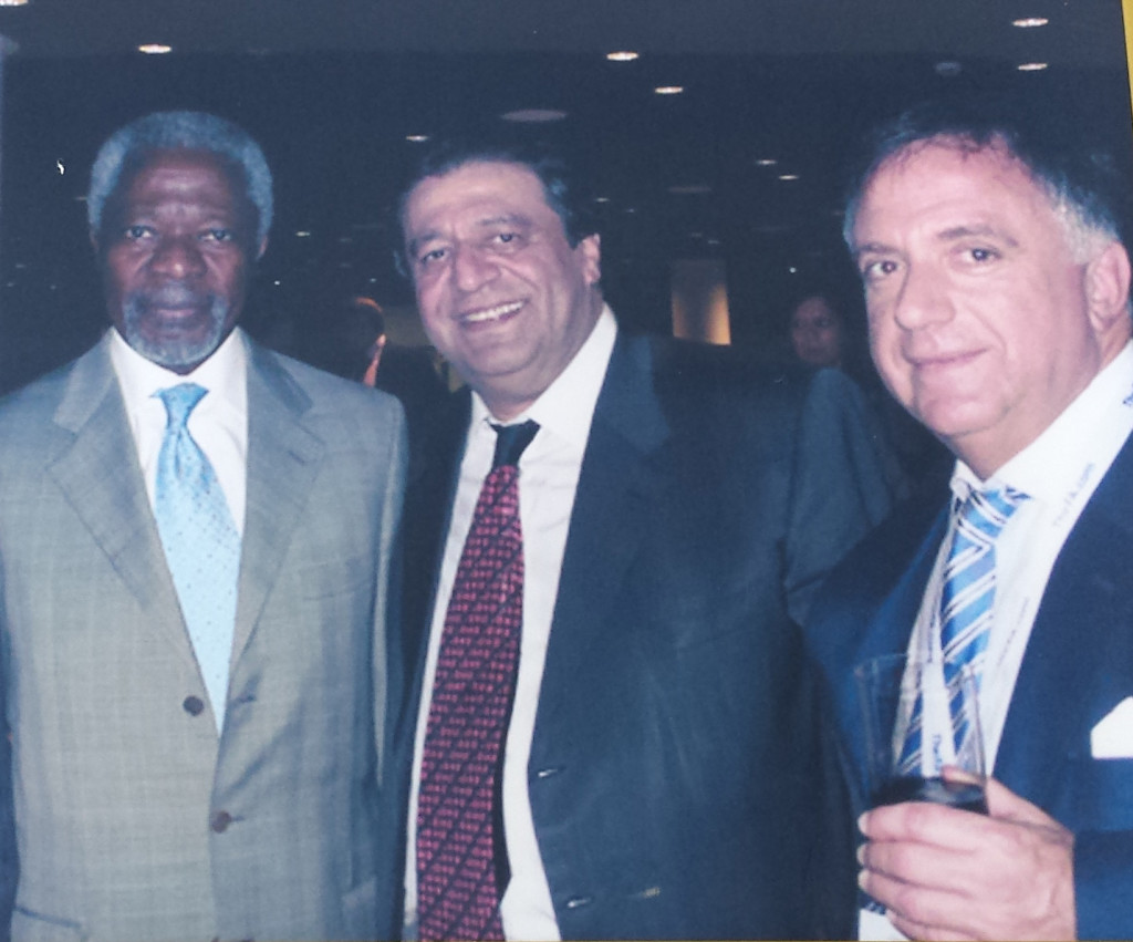Kofi Annan, Secretary General of United Nations; Ramon DeSage; Robert Earl, CEO of Planet Hollywood International.