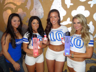 Tropic Beauties holding ZING Vodka and Never Hungover