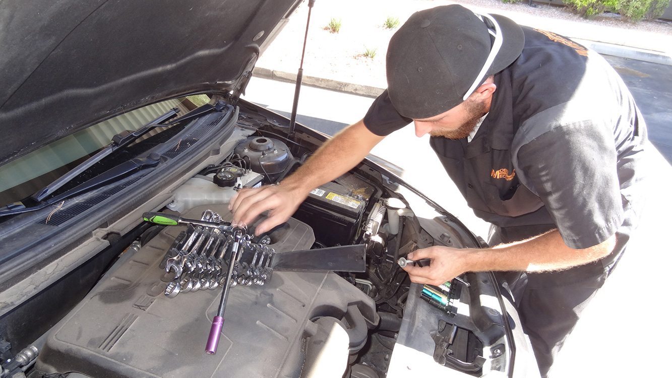 Mobile Mechanics of Las Vegas, Mechanic Tyler Austin Installing A New Battery