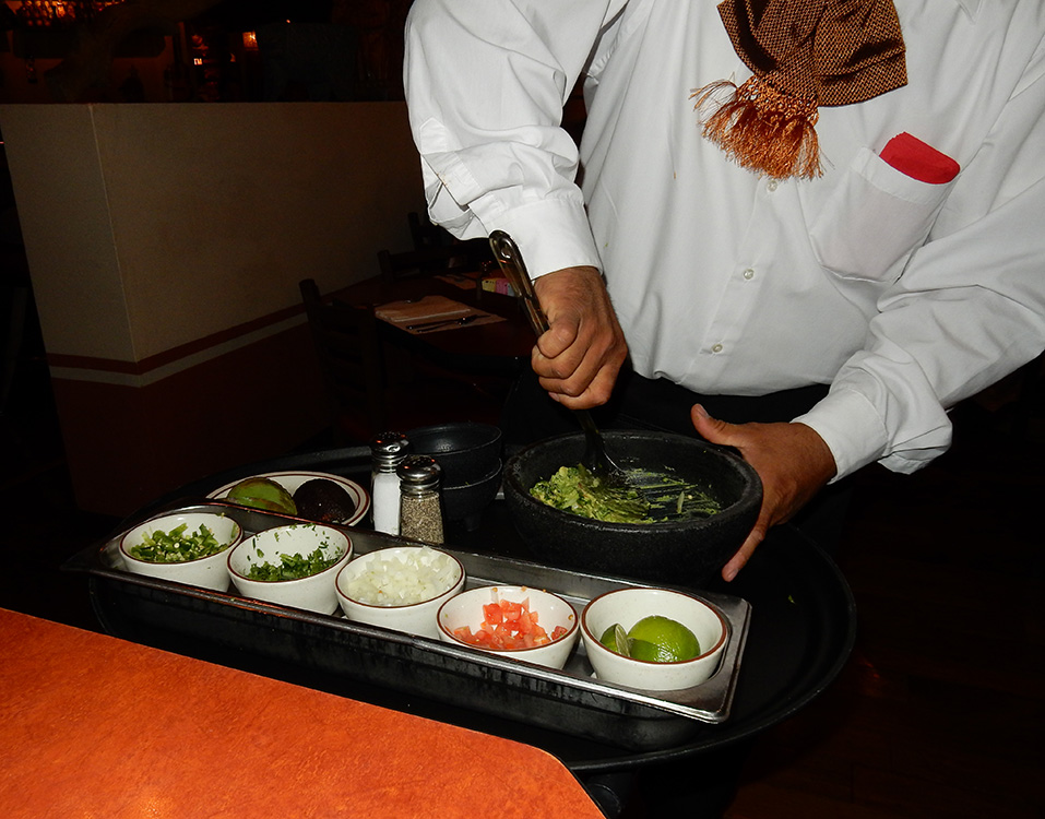 Lindo Michoacan waiter Noa Cano, preparing fresh guacamole at our table, West Flamingo Las Vegas