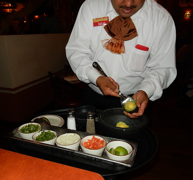 Lindo Michoacan waiter Noe Cano prepares fresh guacamole at our table, West Flamingo Las Vegas