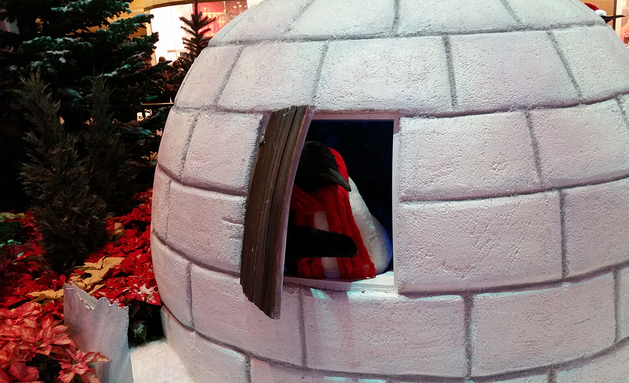 Penguin-Peeking-Out-of-Igloo,-Bellagio-Conservatory-Christmas-Theme,-Las-Vegas-2014