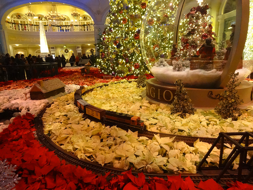 Train-coming-around-the-tracks,-Bellagio-Conservatory-Christmas-Celebration,-2014-Las-Vegas