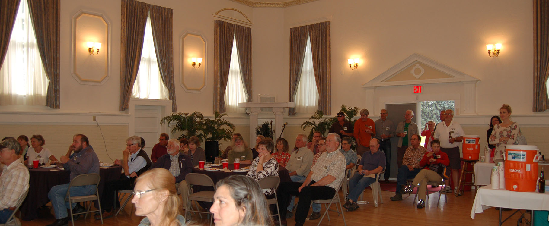 Crowd shot of Vital Ground's 25th anniversary celebration at Heritage Hall, Fort Missoula