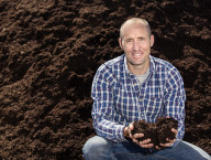 Dane Buk, Terra Firma Organics Owner displays the resulting high quality Ecogro compost after months of diligent processing.